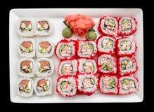 Maki sushi on plate, isolated on black Stock Images