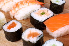 Maki sushi and Prawns Nigiri with cucumber Royalty Free Stock Photos