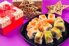 Maki sushi. On purple background royalty free stock photos