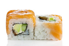 Maki Sushi - Roll. Made of Smoked Eel, Cream Cheese and Vegetables inside. Fresh Salmon outside royalty free stock images
