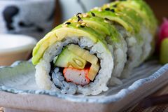 Maki sushi roll with avocado. Maki sushi roll with avocado cutting and serve in Japanese style food stock image
