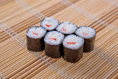 Maki (Sushi Roll) on a bamboo placemat Stock Images