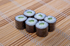 Maki (Sushi Roll) on a bamboo placemat Royalty Free Stock Photography