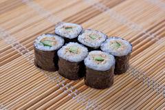 Maki (Sushi Roll) on a bamboo placemat Stock Image