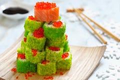 Maki Sushi Roll for Christmas. Maki Sushi Roll Christmas Tree on a table royalty free stock image