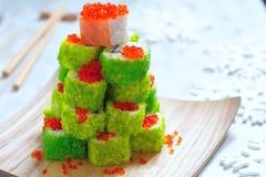 Maki Sushi Roll for Christmas. Maki Sushi Roll Christmas Tree on a table royalty free stock photography