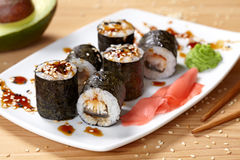 Maki sushi roll with eel, wasabi, ginger and nori Royalty Free Stock Photo