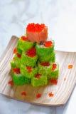 Maki Sushi Roll para la Navidad Fotos de archivo