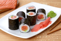 Maki sushi roll with salmon, wasabi, ginger and Royalty Free Stock Photos