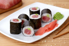 Maki sushi roll with tuna, wasabi, ginger and nori Royalty Free Stock Photos