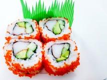 Maki sushi rolls, avocado and crab sushi on a plain white surface. Background rice tobiko uramaki fish food raw wrapped seafood stock photography