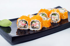 Maki sushi rolls with avocado, salmon and caviar, and crab meat Stock Photos