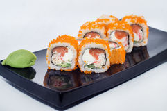 Maki sushi rolls with avocado, salmon and caviar, and crab meat Royalty Free Stock Photography
