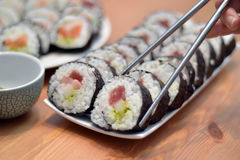 Maki sushi rolls japan food on plate with foodsticks Royalty Free Stock Image