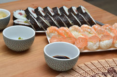 Maki sushi rolls and nigiri sushi japan food on the table with soy sauce Stock Photos