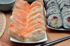 Maki sushi rolls and nigiri sushi with salmon and shrimp japan food on the table detail Royalty Free Stock Photography