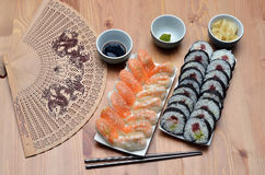 Maki sushi rolls and nigiri sushi with salmon and shrimp japan food on the table with soy sauce Royalty Free Stock Images