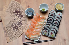 Maki sushi rolls and nigiri sushi with salmon and shrimp japan food on the table with soy sauce and ginger Stock Image