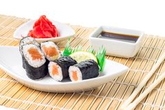 Maki-sushi rolls in plate with chopsticks on bamboo background Royalty Free Stock Photos