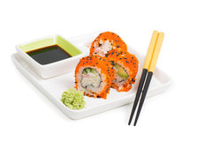 Maki sushi rolls on the plate with chopsticks Royalty Free Stock Photos