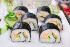 Maki sushi rolls with salmon and avocado Royalty Free Stock Photo