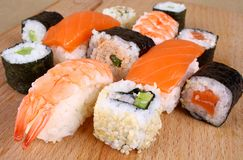 Maki sushi and Salmon Nigiri with cucumber Stock Photo