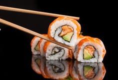 Maki sushi served on black background. With reflection Royalty Free Stock Photos