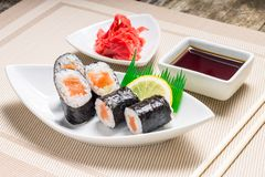 Maki sushi served with wasabi and ginger Royalty Free Stock Photography