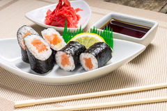 Maki sushi served with wasabi and ginger Royalty Free Stock Photo