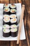 Maki sushi set. On a white plate. Shallow dof stock images
