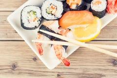 Maki Sushi set. On wooden background stock images