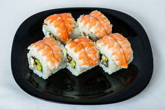 Maki sushi with smoked ell and prawn. Royalty Free Stock Image