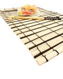 Maki sushi with wasabi on bamboo mat Royalty Free Stock Photography