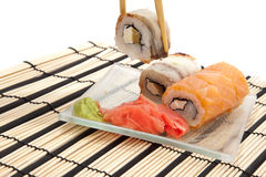 Maki sushi with wasabi on bamboo sushi mat Stock Photo