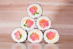 Maki Sushi on wooden background Stock Image