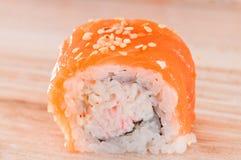 Maki Sushi on wooden background Royalty Free Stock Images