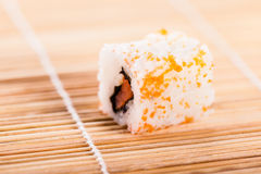 Maki sushi on wooden mat Stock Photo