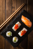 Maki sushi on a wooden table. Top view Royalty Free Stock Photo