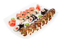 Maki and uramaki sushi set of rolls  on white Stock Photos