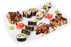 Maki and uramaki sushi set of rolls  on white Royalty Free Stock Photo