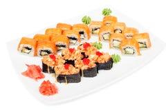 Maki and uramaki sushi set of rolls  on white Stock Photography