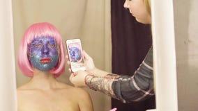 Makijażu artysta strzela twarz model zbiory wideo