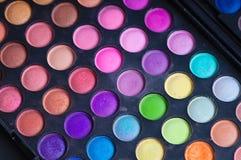Makijażu eyeshadow kolorowe palety odizolowywać na czarnym tle Zdjęcia Stock