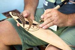 Making aboriginal boomerang Royalty Free Stock Photography
