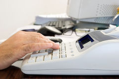 Making the accounts. Making accounts in hard day work Stock Image