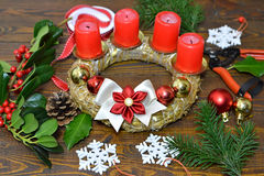 Making Advent wreath. Wooden background stock photo
