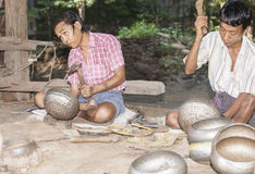 Making alms bowls by hand. Stock Photo