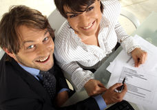 Making an analyses together. Two smiling business people are making an analyses together stock photos