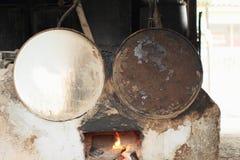 Making arak in barrels Royalty Free Stock Image