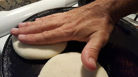 Making arepas Stock Photography